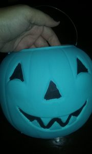 My teal pumpkin is a plastic pumpkin bucket I'll be hanging from a post outside during Trick or Treating
